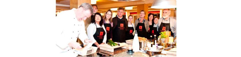 Kochwerkstatt Giovanni und Kochkursteilnehmer
